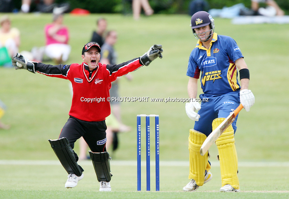 Otago batsman Aaron Redmond is dismissed caught behind by Canterbury wicketkeeper Kruger Van Wyk during the State Shield one day cricket match between the Otago Volts and the Canterbury Wizards at Molyneux Park, Alexandra on Saturday 29 December 2007. Photo: Andrew Cornaga/PHOTOSPORT