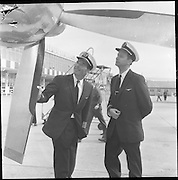 17/08/1962<br /> 08/17/1962<br /> 17 August 1962<br /> Aer Lingus crew members for Royal flight, who would fly Princess Margaret and Lord Snowden to Shannon, for an Irish holiday, from London that day at Dublin Airport. Pictured at last checks are Captain B. Noble and 1st Officer Brian Luffingham who would pilot the plane bringing the Royal's for their Irish holiday.
