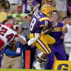 19 September 2009: LSU Tigers running back Trindon Holliday (8) scores past Louisiana-Lafayette Cajuns safety Phillip Nevels (24) during a game between the University of Louisiana Lafayette Ragin' Cajuns and the  LSU Tigers at Tiger Stadium in Baton Rouge, Louisiana.