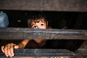 08 JANUARY 2007 - MANAGUA, NICARAGUA:  A child in his home in Mercado Oriental, the main market that serves Managua, Nicaragua. The market encompasses dozens of square blocks and is the largest market in Central America.  Photo by Jack Kurtz