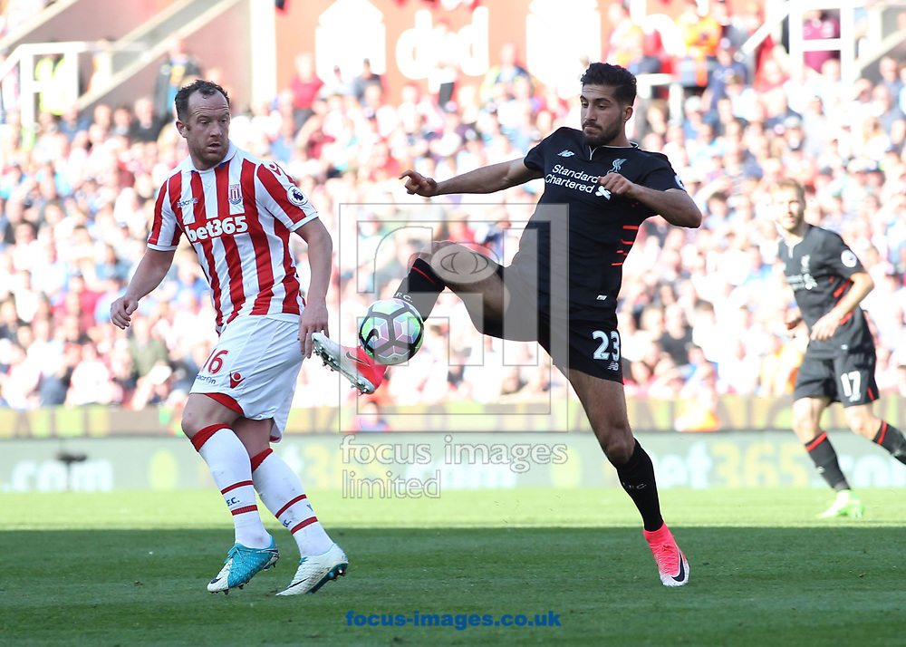 Charlie Adam of Stoke City and Emre Can of Liverpool in action during the Premier League match at the Bet 365 Stadium, Stoke-on-Trent.<br /> Picture by Michael Sedgwick/Focus Images Ltd +44 7900 363072<br /> 08/04/2017