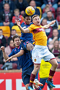 Allan Campbell (#8) of Motherwell FC, Peter Haring (#5) of Heart of Midlothian and Demetri Mitchell (#11)  of Heart of Midlothian compete for a header during the Ladbrokes Scottish Premiership match between Motherwell and Heart of Midlothian at Fir Park, Motherwell, Scotland on 15 September 2018.