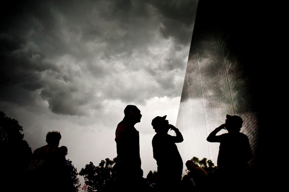 Members of Rolling Thunder search for the name of a comrade on the Vietnam Veterans Memorial On Washington, D.C. on Friday. Rolling Thunder's Memorial Day weekend commemoration ceremonies began with a candlelight vigil where Gold Star mothers are escorted along the Vietnam Veterans Memorial. Gold Star mothers are those who have experienced the loss of a family member during combat.