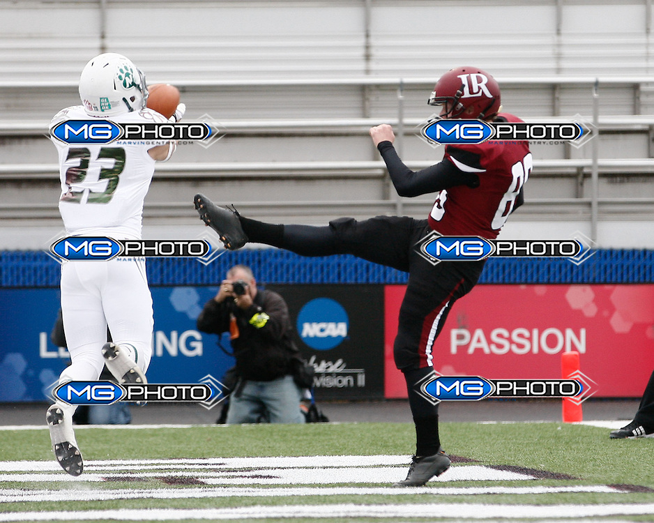 Dec 21, 2013; Florence, AL, USA; Northwest Missouri State Bearcats safety Kevin Berg (23) blocks the punt of  Lenoir-Rhyne Bears punter Austin Barker (89) at Braly Municipal Stadium. Mandatory Credit: Marvin Gentry-