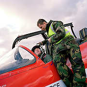 Engineering ground staff of the Red Arrows, Britain's RAF aerobatic team, makes last pre-flight checks before training flight.