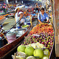 Woman Selling Fruit at Floating Market in Amphawa, Thailand <br />