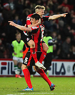 Picture by Tom Smith/Focus Images Ltd 07545141164<br /> 26/12/2013<br /> Matt Ritchie (centre left) of Bournemouth jumps onto Tommy Elphick (centre right) in celebration of scoring the goal to make it 2-0 to his side during the Sky Bet Championship match at the Goldsands Stadium, Bournemouth.