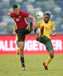 Durban. 080918. Buhlebuyeza Wilson Mkhwanzi of South Africa and Anias Mohamed Jummah Saltoui of Libya battles for the the ball during the 2019 Africa Cup of Nations qualifying match between South Africa and Libya at Moses Mabhida Stadiium in Durban,South Africa. Picture Leon Lestrade. African News Agency. ( ANA ).