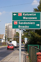 Polish road sign showing directions to Katowice Warsaw Sanomierz Bresko