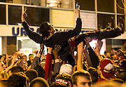 A celebrating fan surfs as he tries to take a selfie after Wisconsin advances to the Final Four.