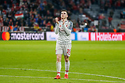 Liverpool defender Andrew Robertson (26) applauds the travelling Liverpool fans after the Champions League match between Bayern Munich and Liverpool at the Allianz Arena, Munich, Germany, on 13 March 2019.