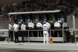 Motorsports / Formula 1: World Championship 2010, GP of Abu Dhabi, control center of Mercedes GP Petronas, 03 Michael Schumacher (GER, Mercedes GP Petronas),