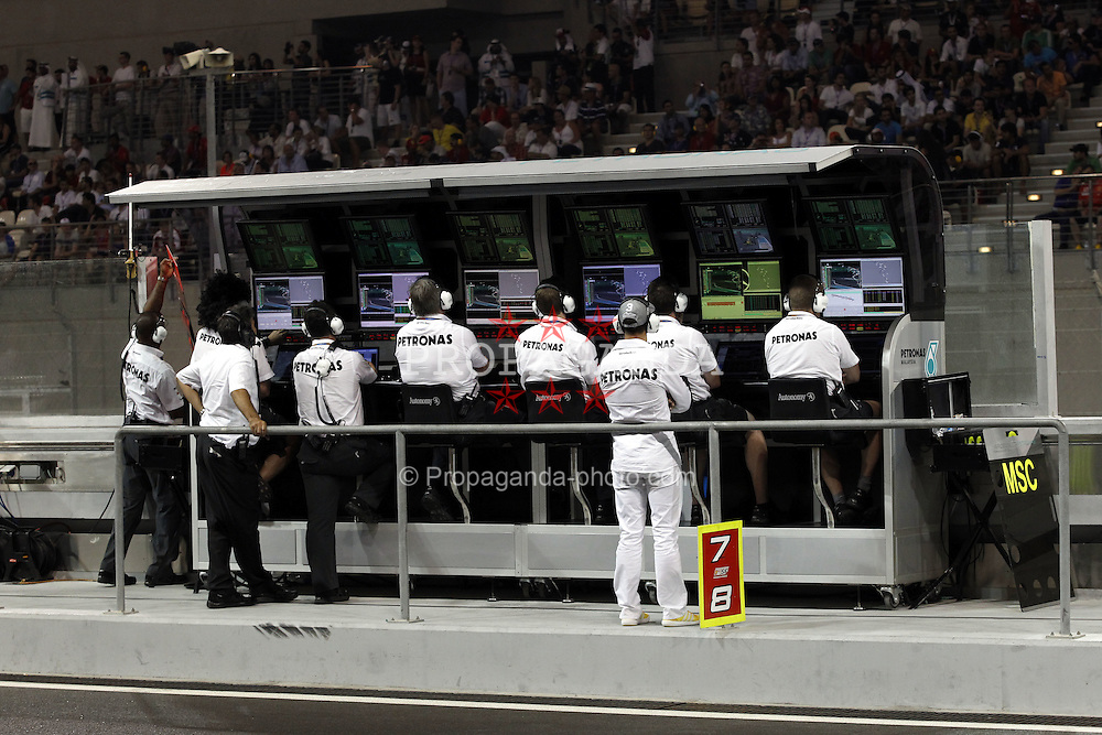 Motorsports / Formula 1: World Championship 2010, GP of Abu Dhabi, control center of Mercedes GP Petronas, 03 Michael Schumacher (GER, Mercedes GP Petronas),