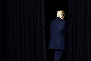 U.S. President Donald Trump exits the stage following a rally at the U.S. Cellular Center in Cedar Rapids, Iowa, U.S. June 21, 2017. REUTERS/Scott Morgan