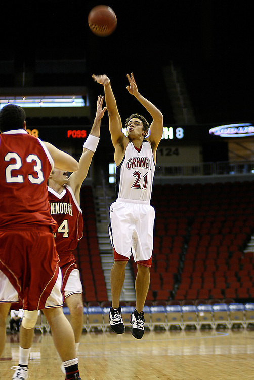 Grinnell Guard Bobby Long '09 pulls up for a three-pointer during Tuesday's game against Monmouth College at the Des Moines Wells Fargo Arena. Long scored 29 points on his way to reaching the 1,500 point plateau.