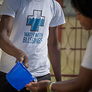 Water With Blessing volunteers use purified water to wash hands in Plassac, Haiti, Sunday, November 6, 2017 Photo: Bryan Woolston / @woolstonphoto