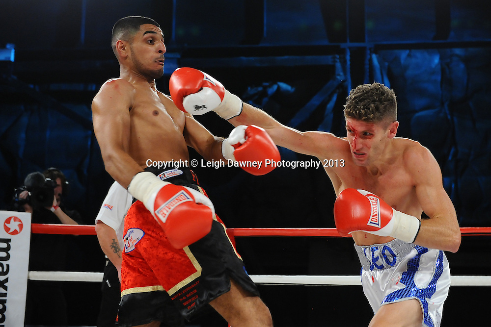 Muheeb Fazeldin (left) defeats Leo D'Erlanger in a boxing contest on Saturday 14th September 2013 at the Magna Centre, Rotherham. Hennessy Sports. Self billing applies. © Credit: Leigh Dawney Photography.
