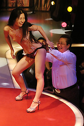 Strippers perform at a lesbian show June 11,  2005 in Tokyo, Japan.