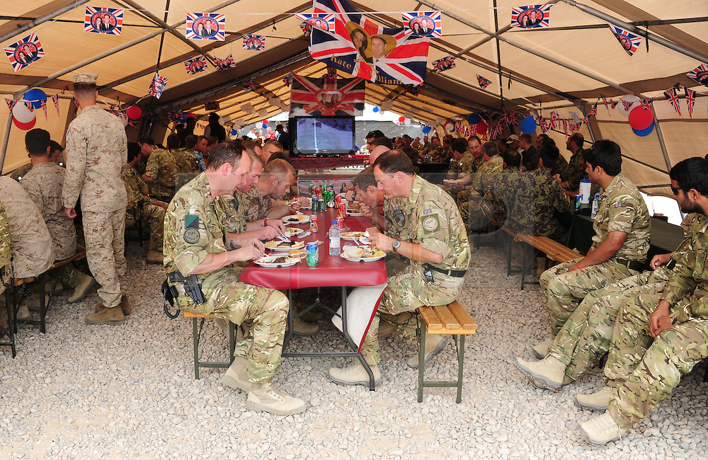 Camp Bastion, Afghanistan  29/04/2011. The Royal Wedding of HRH Prince William to Kate Middleton. Soldiers from 3 Mercian Regiment watch the wedding today in Camp Bastion, Afghanistan.  The soldiers made the most of the event by organising a BBQ and a well deserved day off.  Photo credit should read Alison Baskerville/LNP.