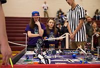 """Outside the Botz"" from Barnstead Maddie Kelley and Genevieve Charity drive their robot ""Jimmy"" under the watchful eyes of the judges during the First Lego League Competition at Gilford Middle School on Saturday.  (Karen Bobotas/for the Laconia Daily Sun)"