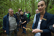 Capilano River Regional Park. Rainforest walk. Tour guide showing a banana snail to tourists.