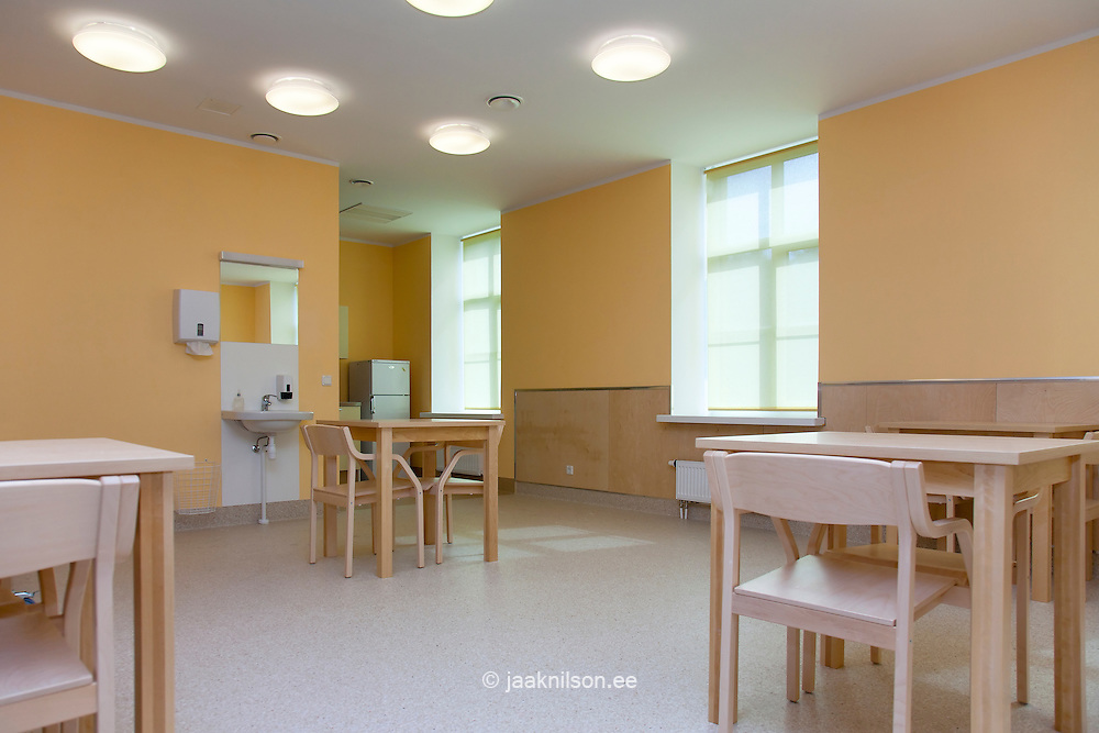 empty hospital dining room with tables and chairs