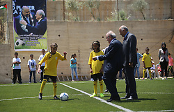 19.05.2015, Ramallah, PSE, FIFA Präsident Blatter besucht Palästina, im Bild der FIFA PRäsident Sepp Blatter bei seinem Palästina Besuch // FIFA chief Sepp Blatter plays soccer with Palestinian children during his visit to Dura al-Qar' village in the West Bank city of Ramallah. Blatter, visiting the Middle East to try to persuade the Palestine FA (PFA) to drop a proposal to suspend Israel from the world body, on Tuesday proposed a peace match between their national teams, Palestine on 2015/05/19. EXPA Pictures © 2015, PhotoCredit: EXPA/ APAimages/ Shadi Hatem<br /> <br /> *****ATTENTION - for AUT, GER, SUI, ITA, POL, CRO, SRB only*****