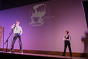 James Anderson portrays Iggy Pop, left, and Jill Rittinger portrays David Bowie at Bowioke at Visual Studies Workshop in Rochester on Saturday, October 31, 2015. The night included David Bowie karaoke and a reenactment of Bowie's 1976 arrest in Rochester.