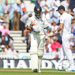 India's Ajinkya Rahane walks back to the Pavillion c & b by England's Chris Jordan for 0 during the first day of the Investec 5th Test match between England and India at the Kia Oval, London, 15th August 2014 © Phil Duncan | SportPix.org.uk