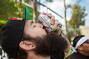 Richard Macleod shotguns a beer while tailgating with his fellow Black Army members before the final game of the Chivas USA franchise at the StubHub Center in Carson, Calif., on Oct. 26, 2014. Chivas USA defeated the San Jose Earthquakes 1-0.