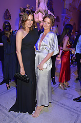 Left to right, YASMIN LE BON and MILLIE MACKINTOSH at a private view of Alexander McQueen's Savage Beauty exhibition hosted by Samsung BlueHouse at the V&A, London on 30th March 2015.