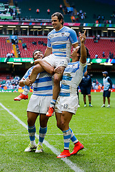 Argentina's Man of the Match Nicolas Sanchez celebrates with Lucas Noguera Paz and Matias Moroni after Argentina win the match - Mandatory byline: Rogan Thomson/JMP - 07966 386802 - 18/10/2015 - RUGBY UNION - Millennium Stadium - Cardiff, Wales - Ireland v Argentina - Rugby World Cup 2015 Quarter Finals.