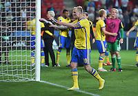 FUSSBALL: UEFA  U21-EUROPAMEISTERSCHAFT  2015  FINALE Schweden - Portugal     30.06.2015  Schweden ist Europameister: John Guidetti  (Schweden) bejubelt den Sieg ueber Portugal und verschenkt seine Schuhe