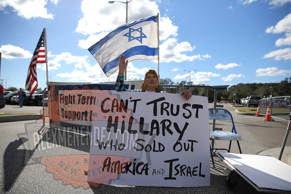 A Hillary Clinton protester is seen outside of a Donald Trump rally during his stop for the US presidential campaign in Tampa, Florida, America - 12  Feb 2016