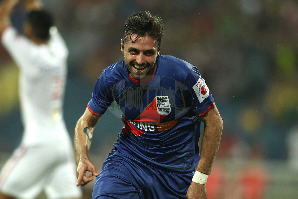Andre Francisco Moritz of Mumbai City FC celebrates scoring his second goal during match 6 of the Hero Indian Super League between Mumbai City FC and FC Pune City held at the D.Y. Patil Stadium, Navi Mumbai, India on the 18th October 2014.<br /> <br /> Photo by:  Shaun Roy/ ISL/ SPORTZPICS