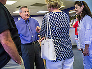 02 JUNE 2012 - PHOENIX, AZ:  Congressman DAVID SCHWEIKERT (R-AZ) and his wife, JOYCE SCHWEIKERT (right) talk to campaign volunteers Saturday. Schweikert met with his campaign staff and volunteers for a pancake breakfast Saturday morning at the campaign headquarters to talk to them about the upcoming primary election against fellow Republican Ben Quayle. Republican incumbents Schweikert and Quayle will face each other in Arizona's Aug. 28 primary election. Redistricting because of the census has thrown the two conservative freshman Republican Congressmen into Arizona's 6th Congressional District. The district is made up of mostly upper middle class neighborhoods in north Phoenix and the wealthy suburban communities of Scottsdale, Fountain Hills and Cave Creek. The District is strongly Republican and whoever wins the Republican primary is expected to easily win November's general election.     PHOTO BY JACK KURTZ