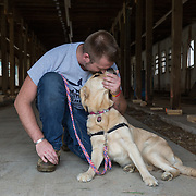 BOYDS, MD - SEP09: Veteran Rory Ready, with his service dog Maria, at the Warrior Canine Connection in Boyds, Maryland. (Photo by Evelyn Hockstein/For The Washington Post)
