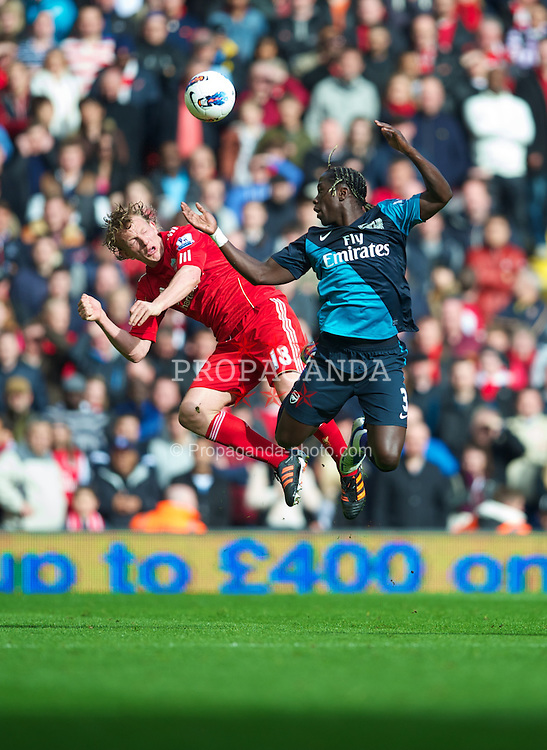 LIVERPOOL, ENGLAND - Saturday, March 3, 2012: Liverpool's Dirk Kuyt and Arsenal's Bacary Sagna during the Premiership match at Anfield. (Pic by David Rawcliffe/Propaganda)