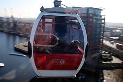 UK ENGLAND LONDON 27FEB15 - Detail view of gondolas of the Emirates Air Line cable car across the river Thames, London. Operated by Transport for London, the service comprises a 1-kilometre (0.62 mi) gondola line that crosses the Thames from the Greenwich Peninsula to the Royal Docks. <br /> <br /> jre/Photo by Jiri Rezac<br /> <br /> &copy; Jiri Rezac 2015