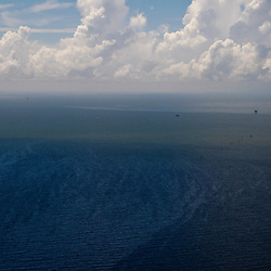 A oil sheen is seen in the Gulf of Mexico off the coast of Louisiana, U.S., on Monday, July 26, 2010. BP Plc is now preparing their 'static kill' option that involves pumping mud into the well to force oil back into the reservoir below. Photographer: Derick E. Hingle