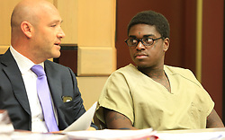 May 4, 2017 - Fort Lauderdale, FL, USA - Rapper Kodak Black, right, speaks with his attorney during a sentencing hearing in connection with the violation of his house arrest, in Fort Lauderdale, Fla., on Thursday, May 4, 2017. He received a sentence of 364 days in jail, but could be released as early as June. (Credit Image: © Carline Jean/TNS via ZUMA Wire)