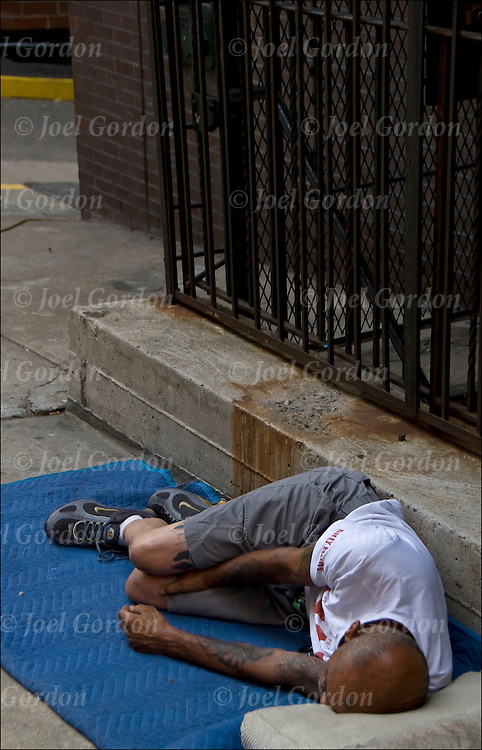 Homeless street person a sleep on the street in New York City.