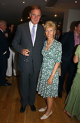 JONATHAN AITKEN and his wife ELIZABETH HARRIS at a party to celebrate the publication of Glass Houses by Sandra Howard held at Tamesa, Oxo Tower Wharf, Barge House Street, London SE1 on 5th September 2006.<br />