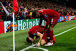 Georginio Wijnaldum of Liverpool helps James Milner of Liverpool - Mandatory by-line: Robbie Stephenson/JMP - 07/05/2019 - FOOTBALL - Anfield - Liverpool, England - Liverpool v Barcelona - UEFA Champions League Semi-Final 2nd Leg
