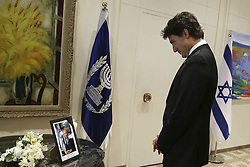September 30, 2016 - Jerusalem, ISRAEL - Canada's Prime Minister Justin Trudeau looks at a portrait of late former Israeli president and prime minister Shimon Peres during a meeting with the Israeli president at the presidential compound in Jerusalem on Friday, Sept. 30, 2016. (Credit Image: © Prensa Internacional via ZUMA Wire)