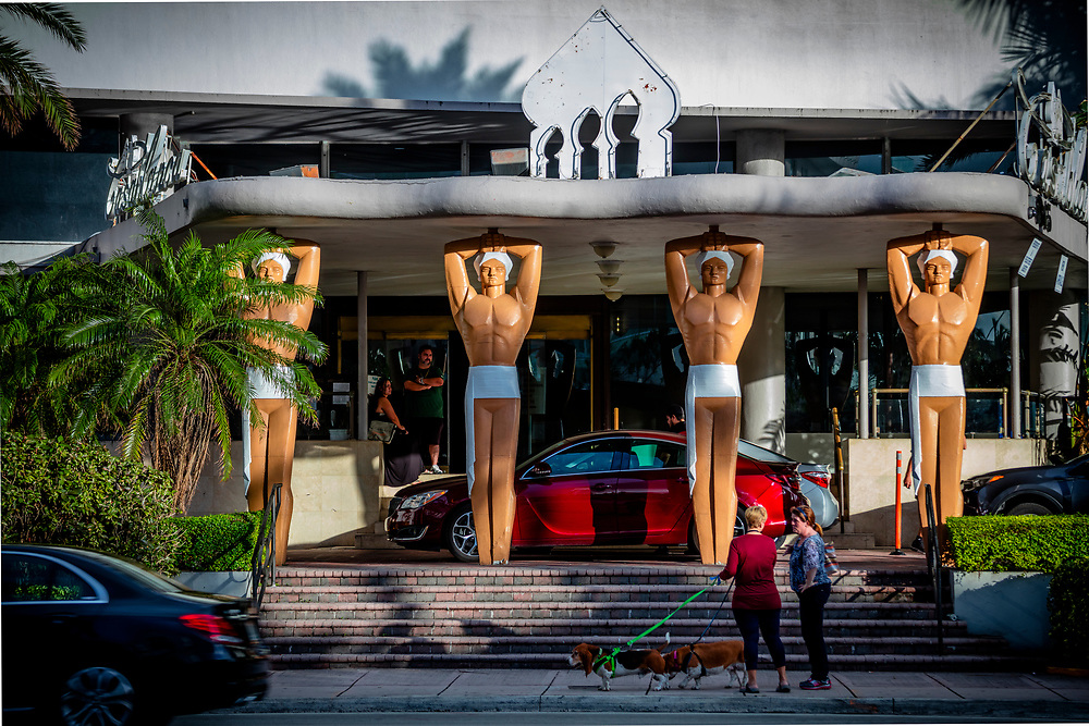 The Miami Modern (MiMo) style Casablanca Hotel in Miami Beach was designed by Roy France in 1949 and features giant, genie-like, figures seemingly  holding up the scalloped concrete canopy on the porte cochere.