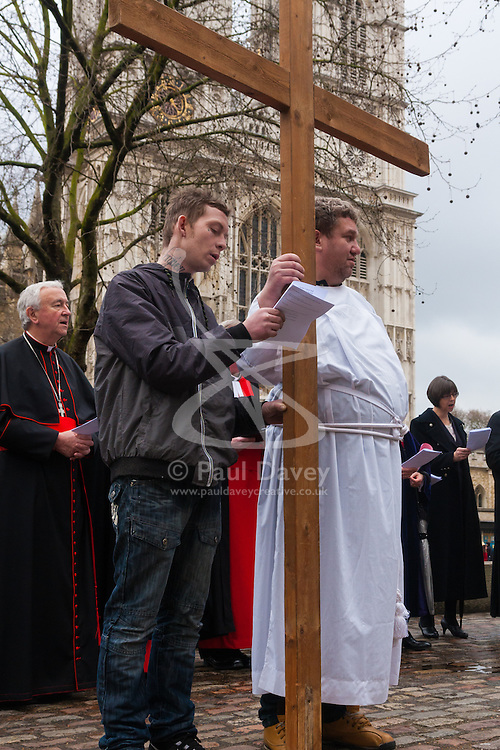 Hundreds of Christians in London take part in the interdenominational Methodist, Anglican and Catholic March of Witness in Westminster. PICTURED: Two members of The Passage, a homeless charity run by the Catholic Church sing hymns as they prepare to carry the cross to Westminster Cathedral.