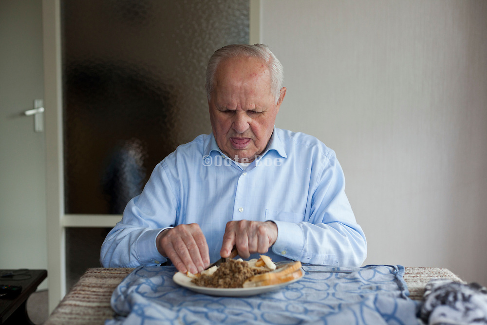 senior man eating alone