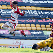 Alfie May jumps over Richard O'Connell during the EFL Sky Bet League 1 match between Bradford City and Doncaster Rovers at the Northern Commercials Stadium, Bradford, England on 6 April 2019.