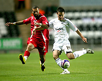 Photo: James Davies.<br />Swansea City v Swindon Town. Coca Cola League 1. 02/10/2007. <br />Swindon`s Christian Roberts battles for posession with Marcos  Painter.